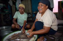 HAL110610A0027  Locals preparing fish to eat, Halmahera, Maluku Islands, Indonesia