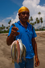 HAL110610A0033  Local man presenting his catch of the day, Halmahera, Maluku Islands, Indonesia